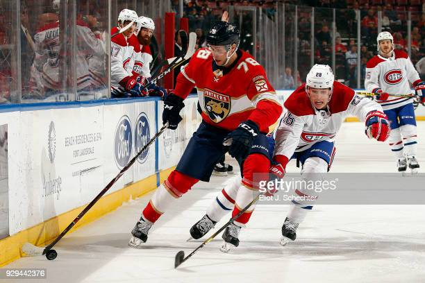 Maxim Mamin of the Florida Panthers skates with the puck against Mike Reilly of the Montreal Canadiens at the BBT Center on March 8 2018 in Sunrise...