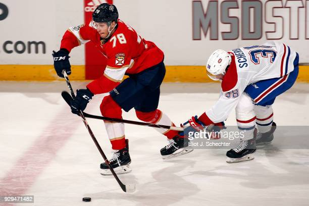 Maxim Mamin of the Florida Panthers skates with the puck against Nikita Scherbak of the Montreal Canadiens at the BBT Center on March 8 2018 in...