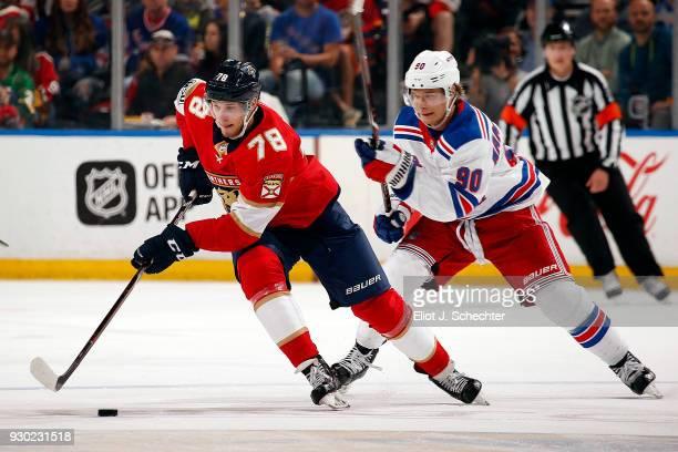Maxim Mamin of the Florida Panthers skates with the puck against Vladislav Namestnikov of the New York Rangers at the BBT Center on March 10 2018 in...