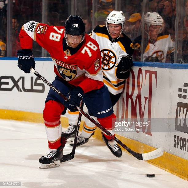 Maxim Mamin of the Florida Panthers skates with the puck against Colby Cave of the Boston Bruins at the BBT Center on April 5 2018 in Sunrise Florida...