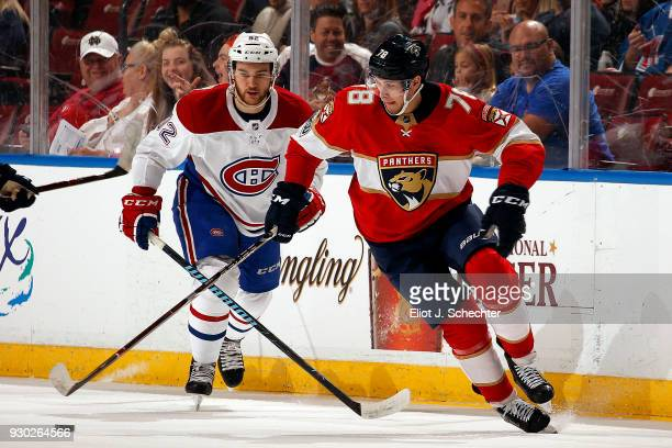 Maxim Mamin of the Florida Panthers skates with the puck against the Jonathan Drouin of the Montreal Canadiens at the BBT Center on March 8 2018 in...