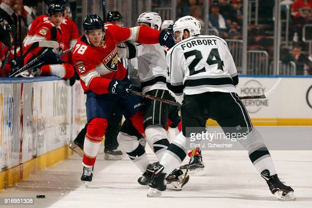 Maxim Mamin of the Florida Panthers tangles with Kyle Clifford and Derek Forbort of the Los Angeles Kings at the BBT Center on February 9 2018 in...