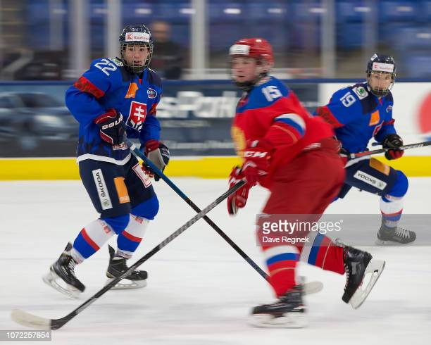 Maxim Masti of the U17 Slovakia Nationals skates up ice next to Daniil Sobolev of the U17 Russian Nationals during day2 of game one of the 2018...