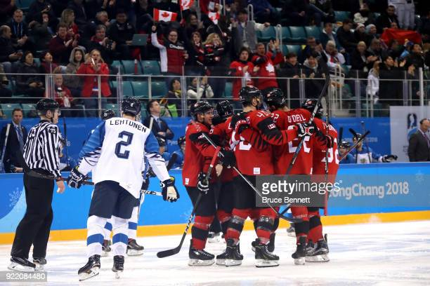 Maxim Noreau of Canada celebrates with teammates after scoring a goal in the third period against Finland during the Men's Playoffs Quarterfinals on...