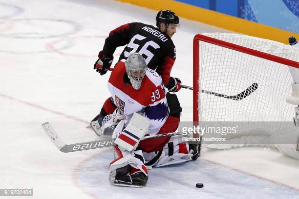 Maxim Noreau of Canada misses a shot against Pavel Francouz of the Czech Republic in a shootout during the Men's Ice Hockey Preliminary Round Group A...