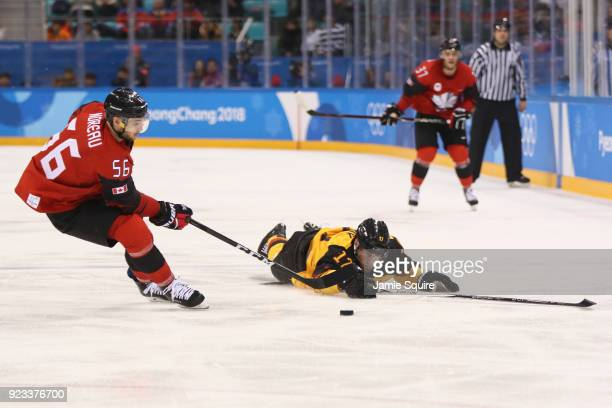Maxim Noreau of Canada skates against Marcus Kink of Germany in the third period during the Men's Playoffs Semifinals on day fourteen of the...