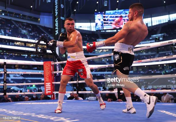 Maxim Prodan attempts to punch Florian Marku during the IBF international welterweight title fight between Maxim Prodan and Florian Marku at...