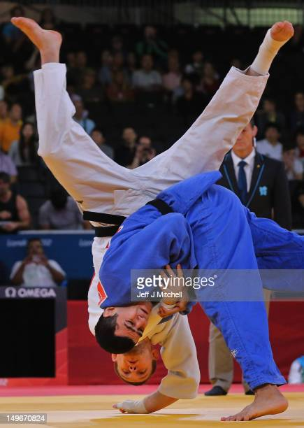 Maxim Rakov of Kazakhstan is thrown by Elmar Gasimov of Azerbaijan on Day 6 of the London 2012 Olympic Games at ExCeL on August 2 2012 in London...