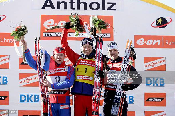 Maxim Tchoudov of Russia second place Ole Einar Bjoerndalen of Norway first place and Vincent Defrasne of France third place celebrate on the podium...
