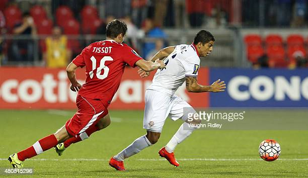 Maxim Tissot of Canada and Christian Gamboa of Costa Rica battle for the ball during the 2015 CONCACAF Gold Cup Group B match between Canada and...