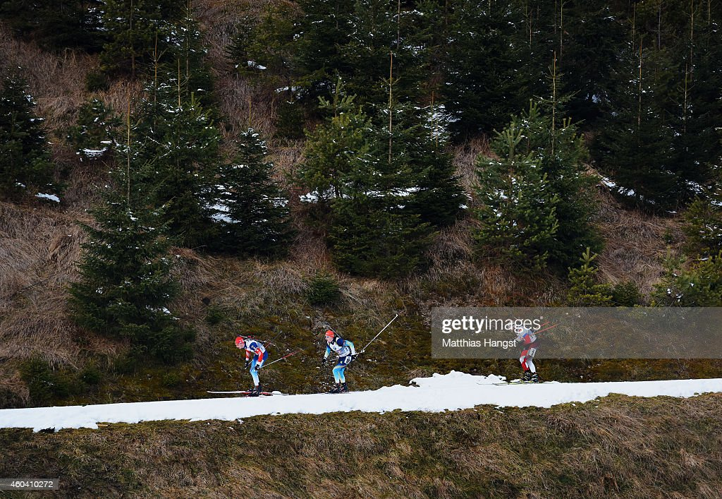 Maxim Tsvetkov (L) of Russia, Dmytro Pidruchnyi (C) of Ukraine and Daniel Mesotitsch (R) of Austria compete during the Men's 4 x 7.5 km relay event in the IBU Biathlon World Cup on December 13, 2014 in Hochfilzen, Austria.