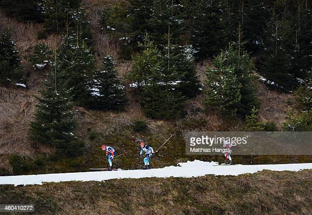 Maxim Tsvetkov of Russia, Dmytro Pidruchnyi of Ukraine and Daniel Mesotitsch of Austria compete during the Men's 4 x 7.5 km relay event in the IBU...