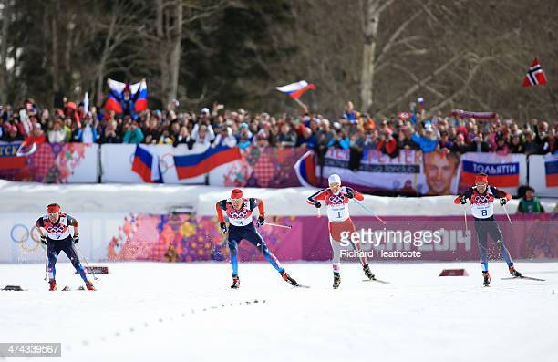 Maxim Vylegzhanin of Russia, Alexander Legkov of Russia, Martin Johnsrud Sundby of Norway and Ilia Chernousov of Russia approach the finish in the...