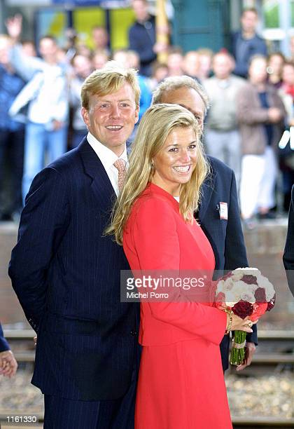 Maxima Zorreguieta and Dutch Crown Prince Willem Alexander smile as the Prince introduces his fiancee to a Dutch crowd September 4 2001 in Den Bosch...