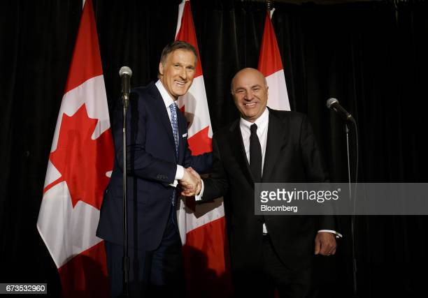 Maxime Bernier, Member of Parliament and Conservative Party leader candidate, left, shakes hands with Kevin O'Leary, chairman of O'Shares Exchange...