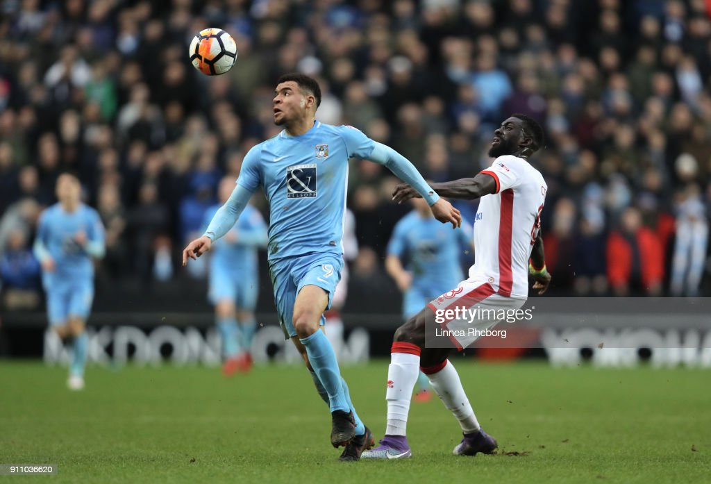 Maxime Biamou and Ousseynou Cisse of Milton Keynes Dons in action during The Emirates FA Cup Fourth Round match between Milton Keynes Dons and Coventry City at Stadium mk on January 27, 2018 in Milton Keynes, England.