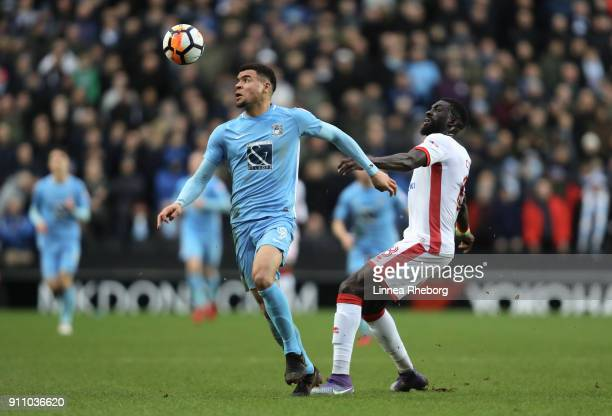 Maxime Biamou and Ousseynou Cisse of Milton Keynes Dons in action during The Emirates FA Cup Fourth Round match between Milton Keynes Dons and...