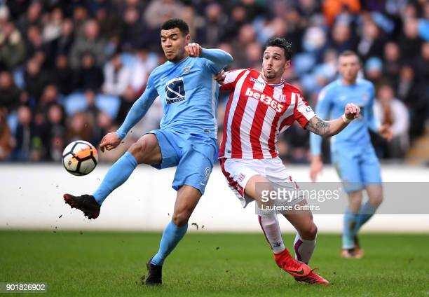 Maxime Biamou of Coventry City and Geoff Cameron of Stoke City during the The Emirates FA Cup Third Round match between Coventry City and Stoke City...