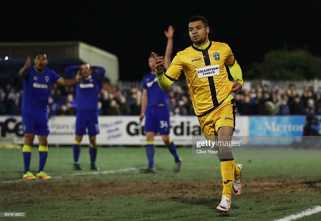 Maxime Biamou of Sutton United celebrates scoring his sides second goal during the Emirates FA Cup third round replay between AFC Wimbledon and Sutton United at The Cherry Red Records Stadium on January 17, 2017 in Kingston upon Thames, England.