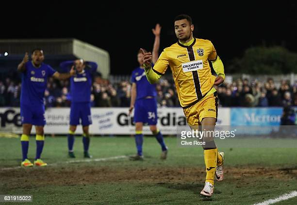 Maxime Biamou of Sutton United celebrates scoring his sides second goal during the Emirates FA Cup third round replay between AFC Wimbledon and...