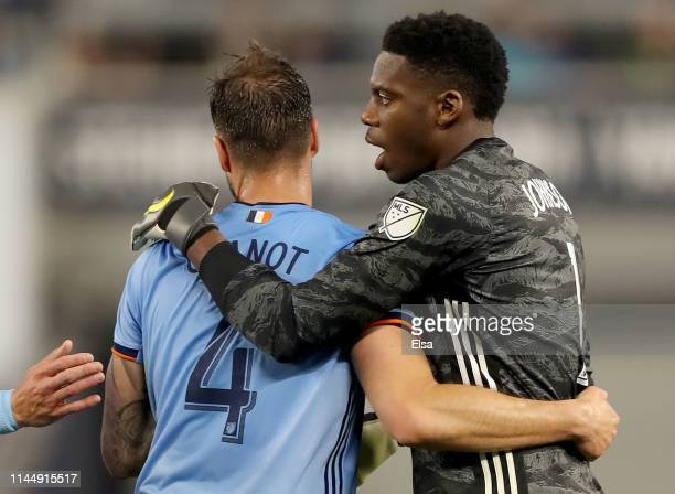 Maxime Chanot and Sean Johnson of New York City FC celebrate the win over the Chicago Fire at Yankee Stadium on April 24 2019 in the Bronx borough of...