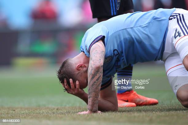 Maxime Chanot of New York City FC holds his head after a clash of heads form a corner kick during the New York City FC Vs San Jose Earthquakes...