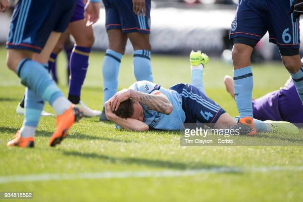 Maxime Chanot of New York City holds his head after a head clash with Jonathan Spector of Orlando City during the New York City FC Vs Orlando City SC...