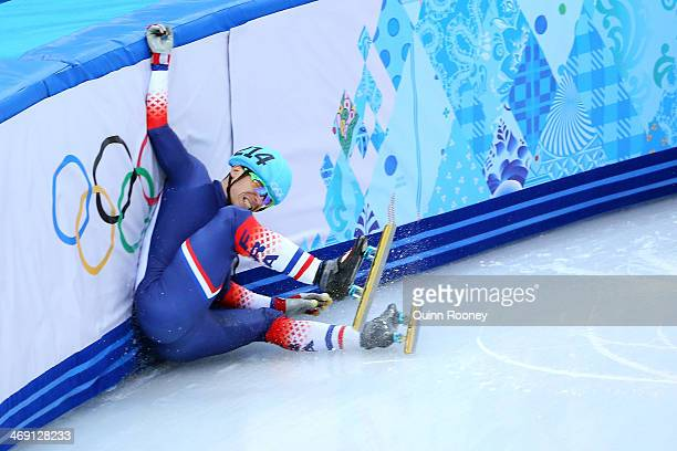 Maxime Chataignier of France falls as he competes in the Short Track Men's 1000 m Heat on day 6 of the Sochi 2014 Winter Olympics at at Iceberg...