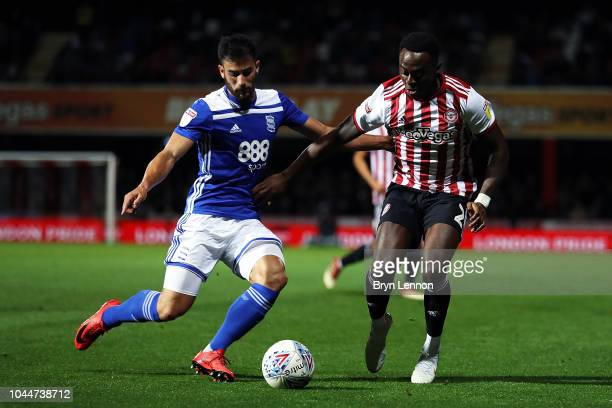 Maxime Colin of Birmingham City battles with Moses Odubajo of Brentford during the Sky Bet Championship match between Brentford and Birmingham City...