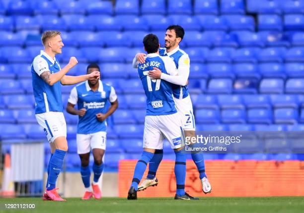 Maxime Colin of Birmingham City celebrates with teammates Mikel San Jose and Kristian Pedersen after scoring his team's first goal during the Sky Bet...
