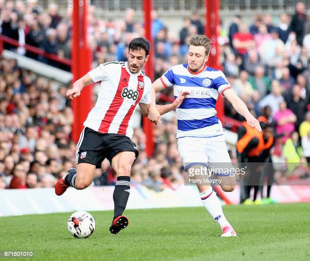 Maxime Colin of Brentford and Luke Freeman of Queens Park Rangers challenge for the ball during the Sky Bet Championship match between Brentford and...