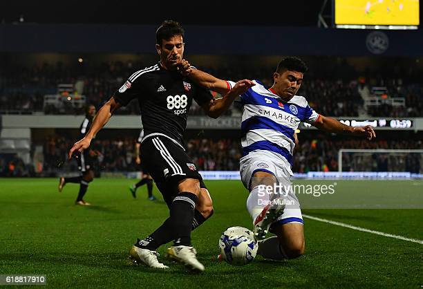 Maxime Colin of Brentford battles for the ball with Massimo Luongo of Queens Park Rangers during the Sky Bet Championship match between Queens Park...