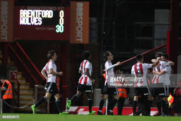 Maxime Colin of Brentford celebrates after scoring a goal to make it 10 during the Sky Bet Championship match between Brentford and Wolverhampton...