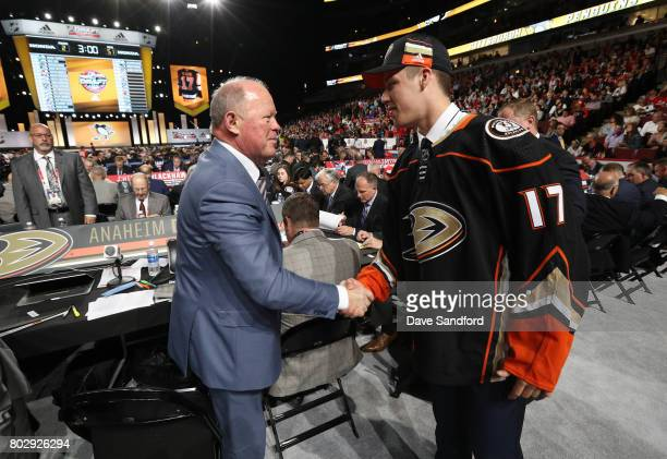 Maxime Comtois is greeted by general manager Bob Murray of the Anaheim Ducks after being selected 50th overall by the Anaheim Ducks during the 2017...