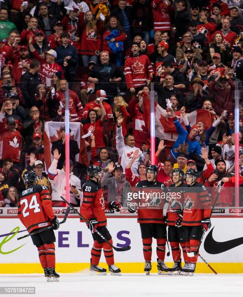 Maxime Comtois of Canada celebrates his third goal of the game against Denmark with teammates Ty Smith Brett Leason Morgan Frost and Ian Mitchell in...