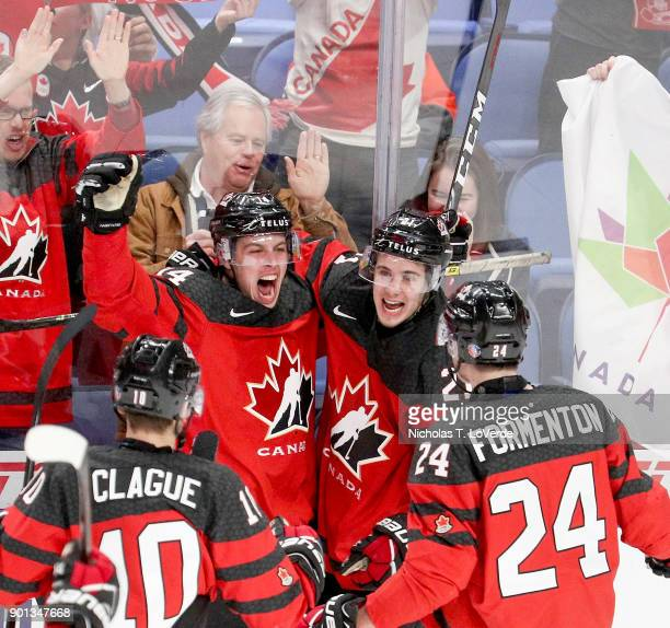 Maxime Comtois of Canada celebrates with Kale Clague Alex Formenton and Brett Howden after Comtois' goal gave team Cananda a 41 lead during the...