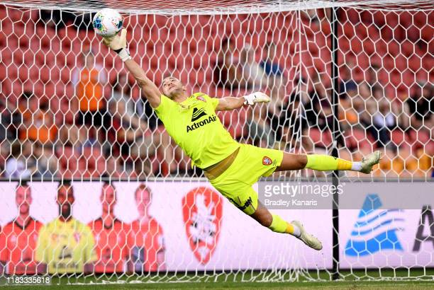 Maxime Crocombe of the Roar saves a goal during the round three ALeague match between the Brisbane Roar and the Melbourne Victory at Suncorp Stadium...