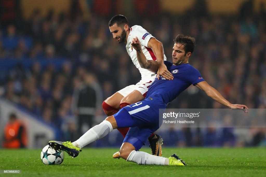 Maxime Gonalons of AS Roma and Cesc Fabregas of Chelsea battle for possession during the UEFA Champions League group C match between Chelsea FC and AS Roma at Stamford Bridge on October 18, 2017 in London, United Kingdom.