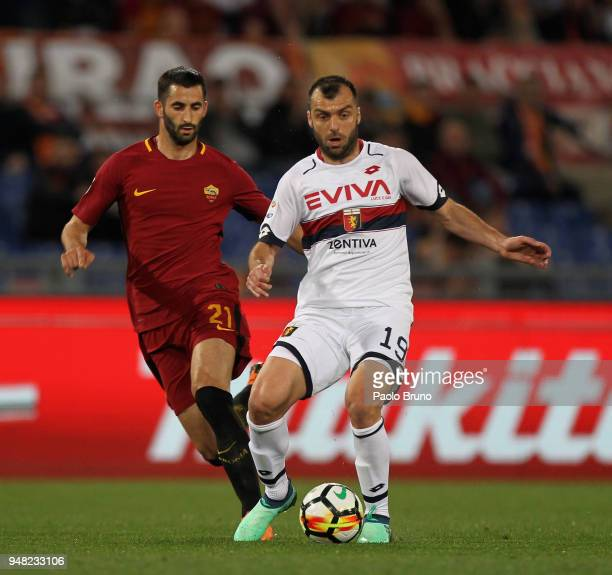 Maxime Gonalons of AS Roma competes for the ball with Goran Pandev of Genoa CFC during the serie A match between AS Roma and Genoa CFC at Stadio...