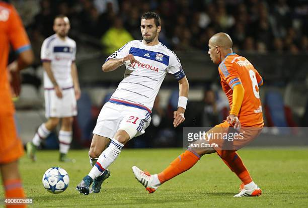 Maxime Gonalons of Lyon and Sofiane Feghouli of Valencia CF in action during the UEFA Champions league match between Olympic Lyonnais and Valencia CF...