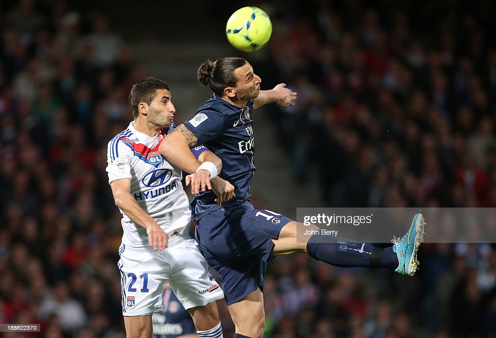 Maxime Gonalons of Lyon and Zlatan Ibrahimovic of PSG in action during the Ligue 1 match between Olympique Lyonnais, OL, and Paris Saint-Germain FC, PSG, at the Stade Gerland on May 12, 2013 in Lyon, France.