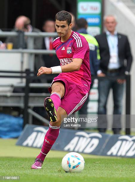 Maxime Gonalons of Lyon runs with the ball during the pre season friendly match between Hannover 96 and Olympique Lyon at the AWD Arena on July 24...