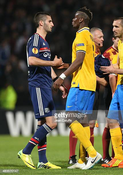 Maxime Gonalons of Lyon shakes hands with Paul Pogba of Juventus Turin at the end of the UEFA Europa League quarter final match between Olympique...