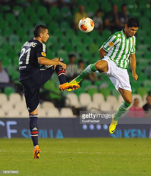 Maxime Gonalons of Olympique Lyonnais challenges Juanfran of Real Betis Balompie during the UEFA Europa League group stage match between Real Betis...
