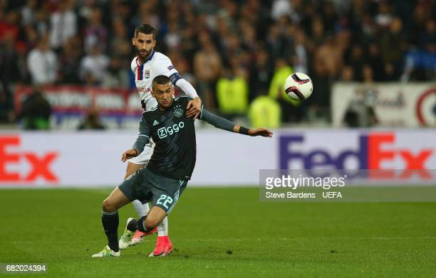 Maxime Gonalons of Olympique Lyonnais Lyon pulls back Hakim Ziyech of Ajax Amsterdam during the Uefa Europa League semi final second leg match...
