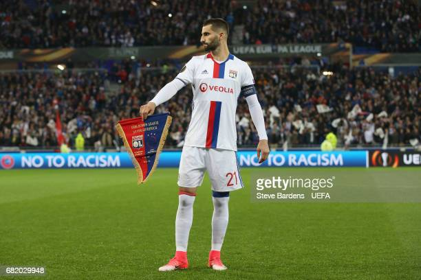 Maxime Gonalons of Olympique Lyonnais Lyon stands with the match day pennant prior to the Uefa Europa League semi final second leg match between...