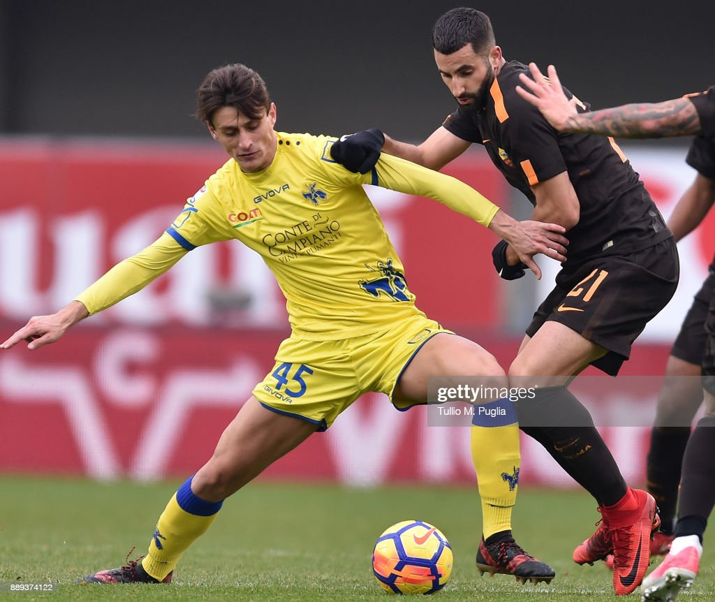 Maxime Gonalons (L) of Roma and Fabrizio Cacciatore of Chievo Verona compete for the ball during the Serie A match between AC Chievo Verona and AS Roma at Stadio Marc'Antonio Bentegodi on December 10, 2017 in Verona, Italy.