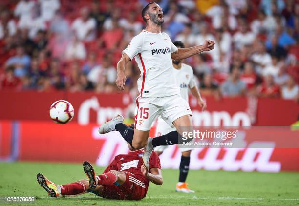 Maxime Gonalons of Sevilla FC competes for the ball with David Houska of SK Sigma Olomouc during the UEFA Europa League Play Off Second Leg match...