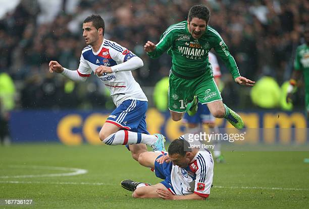Maxime Gonalons Steed Malbranque of Lyon and Fabien Lemoine of SaintEtienne in action during the Ligue 1 match between Olympique Lyonnais OL and AS...