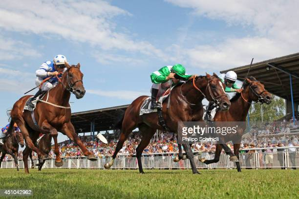 Maxime Guyon riding Oak Harbour defeats Daniele Porcu riding Firestorm during the 34 Swiss Derby horse racing on June 22 2014 in Frauenfeld...